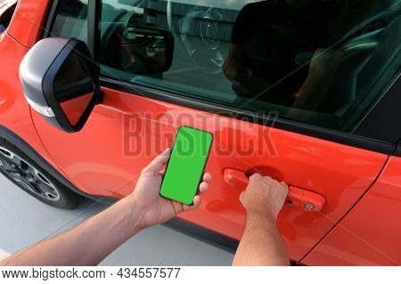 Man Using Smartphone, Holding In Hand Near The Car.