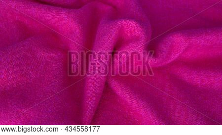 Background With Wavy Lines Made Of Natural Silk Fabric Of Different Colors. Pink Fabric Background.