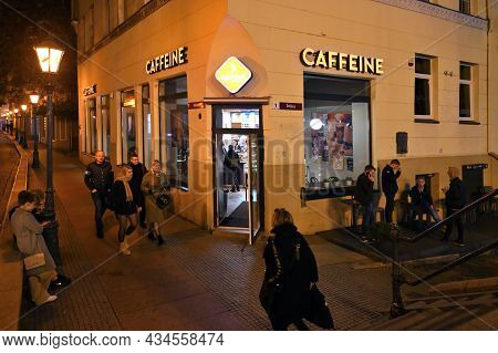 Klaipeda, Lithuania - September 25: Unknown People Rest In Caffee In City Center, Night Time At Sept