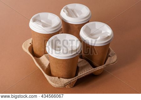 Paper Cups In A Cup Holder For Takeaway Coffee. Paper Cup With A Drink. Disposable Tableware. Eco Ca