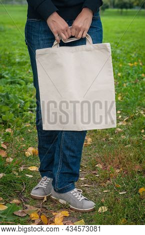 Stylish Woman Holding White Blank Canvas Tote Shopping Bag