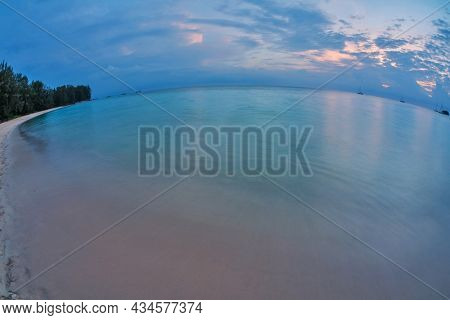 Tropical beach at beautiful sunset in fish-eye lense. Nature background