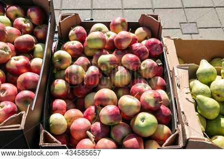Apples And Pears In Cardboard Boxes On The Market. Collection And Sale Of Apples And Pears.
