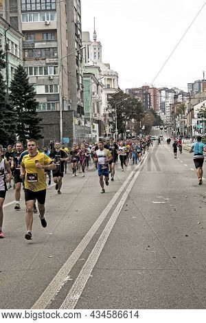 Residents Of The City At The Marathon Race On The Asphalt Roads.
