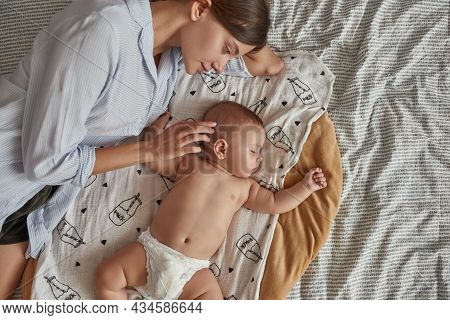 Portrait Of Lovely Undressed Angel Like Baby, Peacefully Sleeping Near Mother After Breastfeeding In