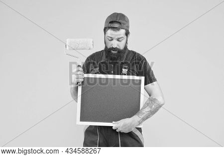 I Think I Can Help You. Foreman Advertises The Service Of Wall Facing. Man With Board Copy Space. Ma