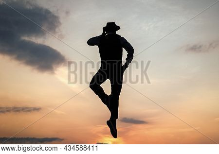 Speaking On Phone. Man Silhouette Jump On Sky Background. Confident Businessman Jumping. Daily Motiv