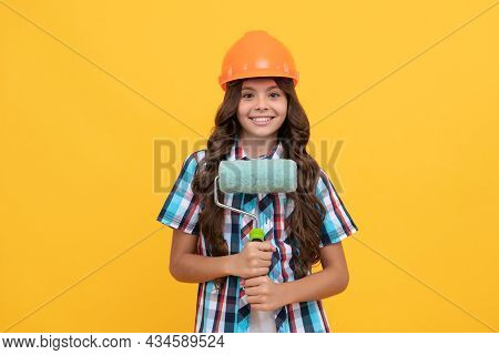Happy Kid With Curly Hair In Construction Helmet Hold Paint Roller, Renovation