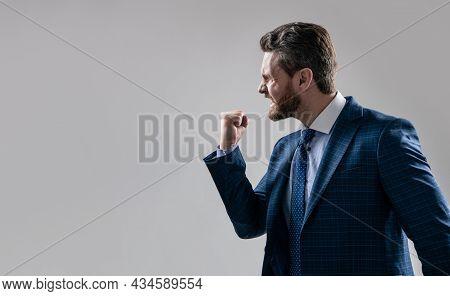 Aggressive Man Businessman In Suit Make Threaten Gesture Shaking Fist At Somebody, Threatening