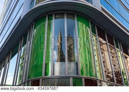 Windows With Colorful Glass And Reflections Of Buildings.
