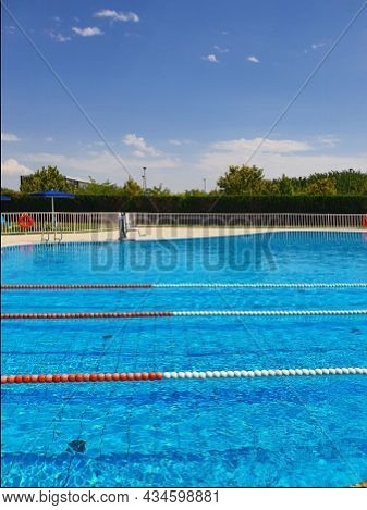View Of Empty Outdoor Pool With Swimming Lanes On Summer Sunny Holiday Day