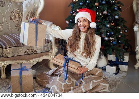 Christmas Woman White Sweater Santa Hat Sitting Floor Near Christmas Tree Wrapped Herself Blanket. C