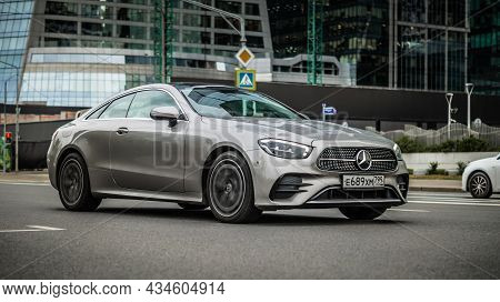 Moscow, Russia - August 2021: Mercedes-benz E-class Coupe C238 Driving On The Street, Front Side Vie