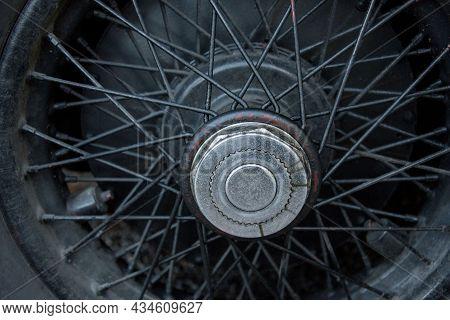 Close Up Of A Spoke Rim Of A Vintage Car