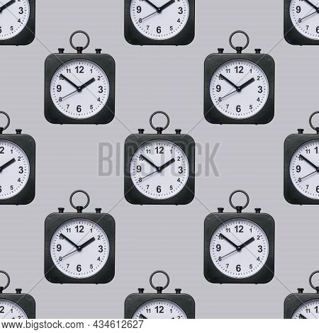 Seamless Pattern Of Classic Watches With Hands On A Gray Background. Crassic Dial.