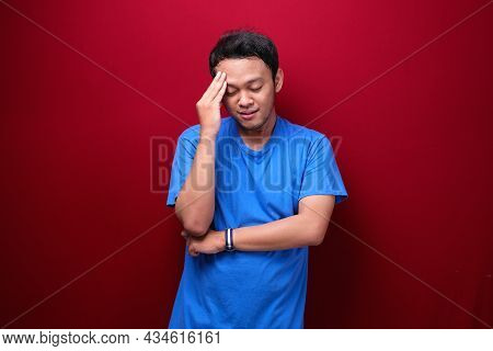 Thinking Young Asian Man Is Seriously Think Gesture On Red Background