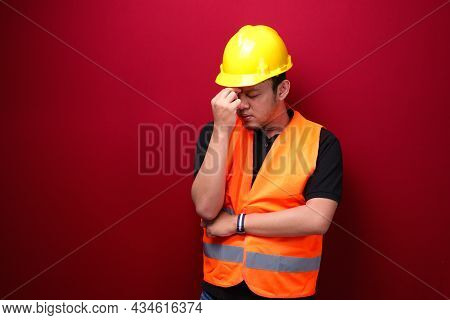 Confused And Stress Face Of Young Asian Man Worker With Hand Gesture. Advertising Model Concept.