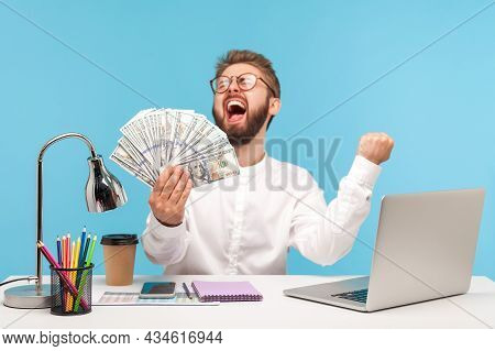 Extremely Happy Satisfied Man Office Worker Screaming Holding In Hand Big Sum Of Dollars, Winning Ja