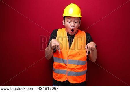 Wow Young Asian Man Worker Is Surprised And Shouting With Pointing Bottom With His Hand On Red Backg
