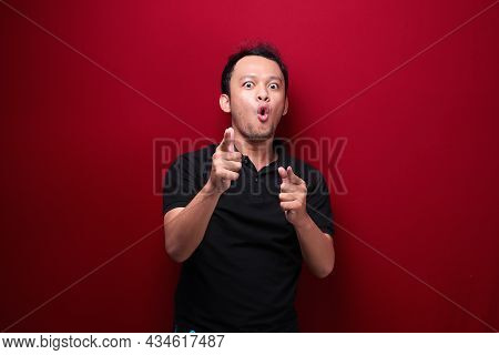 Wow And Shocked Face Of Young Asian Man With Open Hand Gesture. Advertising Model Concept.