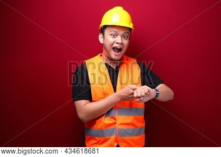Happy Young Asian Man Workers When See Watch