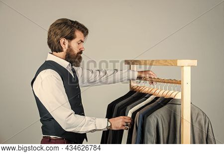 Shopper Hipster Man In Fitting Room Menswear Store, Choosing Clothes Concept