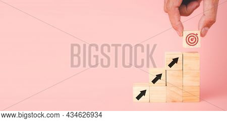 Hand Holding Virtual Target Board And Arrow Which Icon On Wooden Cube With Copy Space, Target And Go