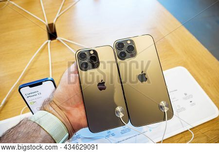 Paris, France - Sep 24, 2021: Male Hand Compare New Iphone 13 Pro And 13 Pro Max Smartphone Model By