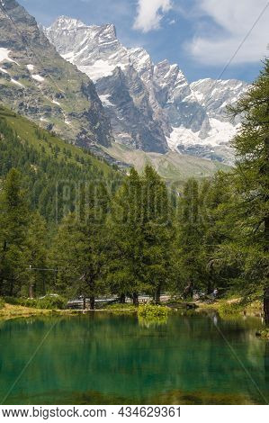 Idyllic Lake With High Alps In The Background During Summer Season, Valtournenche, Aosta Valley, Ita