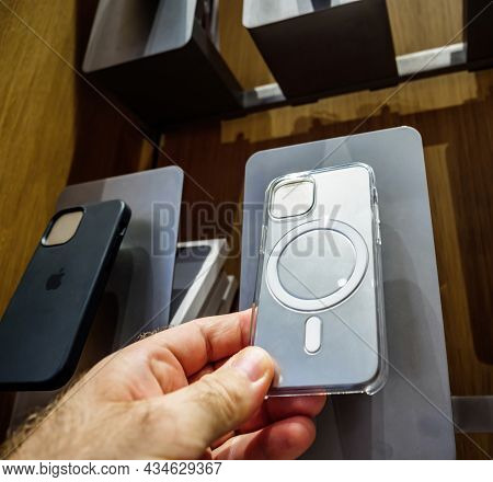 Paris, France - Sep 24, 2021: Male Hand Looking At Transparent Silicone Protection Cases For Iphone