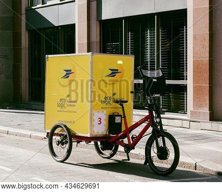 Paris, France - Sep 24, 2021: New Yellow La Poste Postal Bike With Electric Motor And Big Eco Logic