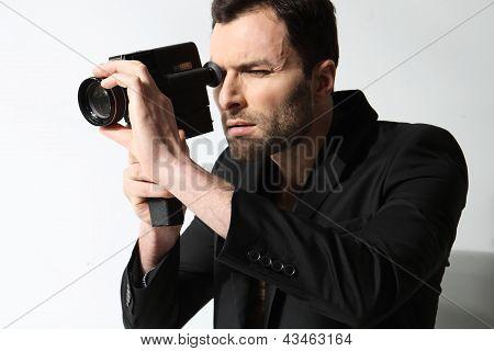 Attractive man taking photo