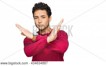 Young handsome man wearing casual clothes rejection expression crossing arms doing negative sign, angry face