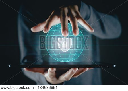 Man Holding Tablet With Padlock Shield Protects Security Icon On The Virtual Display.  Cyber Securit