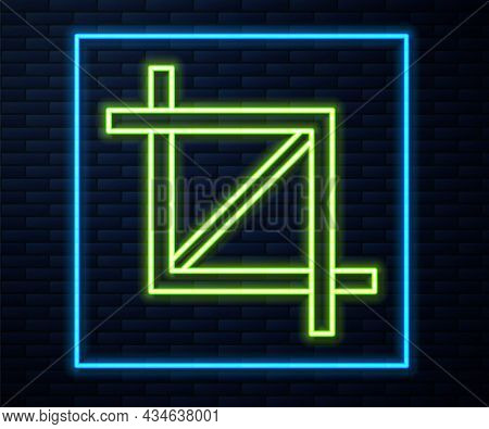 Glowing Neon Line Picture Crop Photo Icon Isolated On Brick Wall Background. Vector