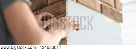 Male Tiler Is Laying Brick-shaped Tiles On Concrete Column