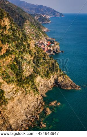 Beautiful coastline of Cinque Terre with the Vernazza town by the Ligurian Sea, Italy