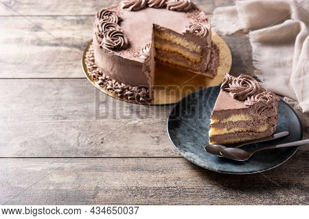 Piece Of Chocolate Truffle Cake On Wooden Table.  Copy Space