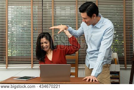 Boss Attempts To Touch The Shoulder Of A Young Female Employee In Office At Workplace. She Is Uncomf
