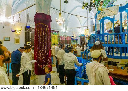 Safed, Israel - September 28, 2021: Jewish People Pray, Part Of Simchat Torah Tradition, In The Old