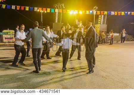 Safed, Israel - September 28, 2021: Jewish Men Dance To Musicians Songs, Part Of Simchat Torah Tradi