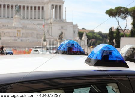 Blue Sirens Of The Car Of The Italian Police Forces And The Famous Monument Called Altare Della Patr