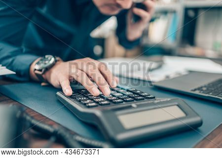 Financial Businessman Working On Desk Office Using A Calculator To Calculate Calculating Corporate I
