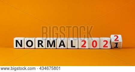 Symbol Of Covid-19 Normal In 2022. Turned A Wooden Cube And Changed Words 'normal 2021' To 'normal 2