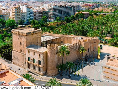 an aerial view of the Altamira Castle and the famous Palmeral de Elche, also known as Palm Grove of Elche, a public park with many palm trees in Elche, in the Valencian Community, Spain