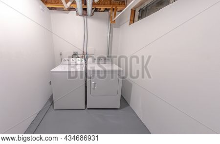 A Laundry And A Dryer High Efficiency Machines