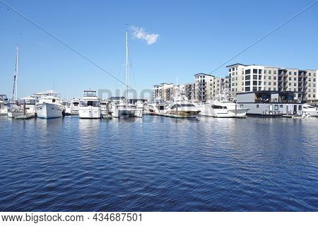 The Riverwalk Along The Cape Fear River In Downtown Wilmington Nc, With A Marina, Houseboats And Apa