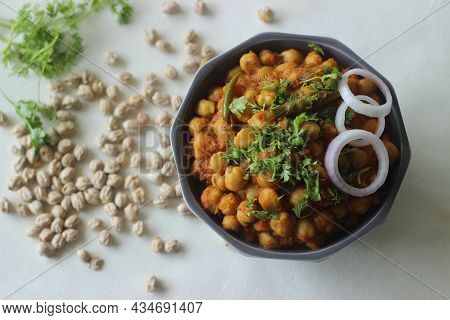 White Chickpea Gravy With Tomatoes Onions And Spices. Popularly Called As Chole Masala. Shot On Whit