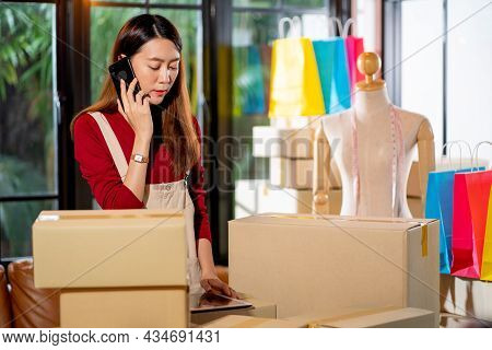 Young Asian Woman Use Mobile Phone To Call To Customer Of Online Product Selling And She Sell Produc