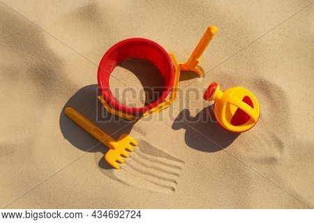 Set Of Plastic Beach Toys On Sand, Flat Lay. Outdoor Play